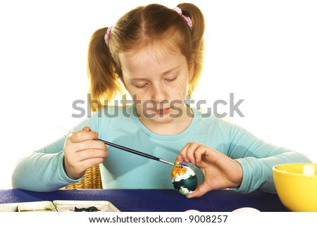 cute girl is painting easter eggs