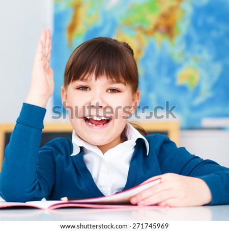 Cute girl is reading book - school, education concept