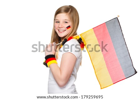 cute girl jubilating with german flags for german team - stock photo