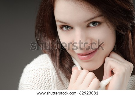 Cute girl keeping warm - stock photo