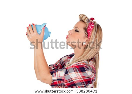 Cute girl kissing a money box in pinup style isolated on a white background - stock photo