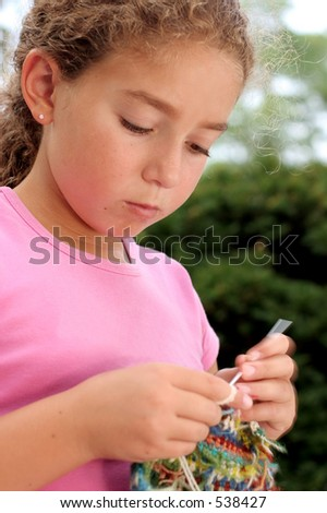 Cute girl knitting - stock photo