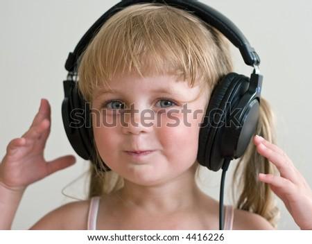 cute girl listening music at headphones - stock photo