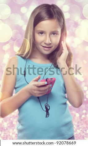 Cute girl listening to music on cell phone - stock photo