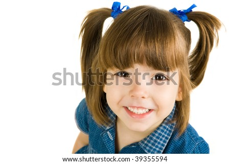 Cute girl looking at camera with smile - stock photo