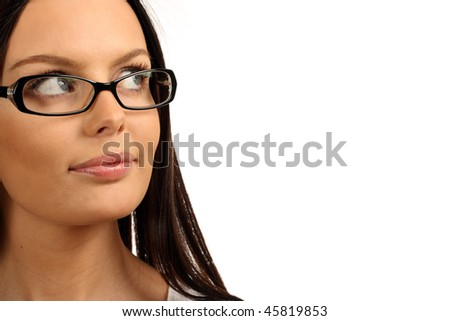 Cute girl looking at copy space. Close-up of a young woman wearing glasses. - stock photo