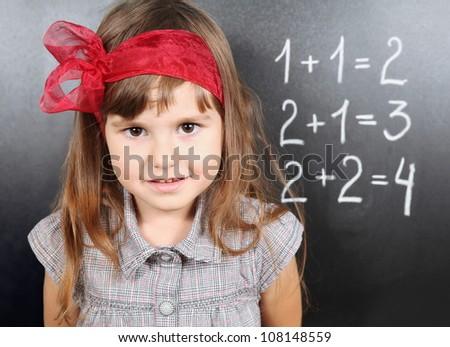 Cute Girl Near Blackboard Learning Maths Portrait - stock photo