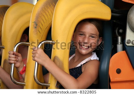 Cute girl on Roller Coaster - stock photo