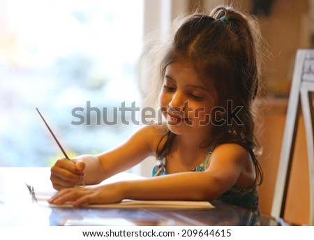 Cute girl painting a picture  - stock photo