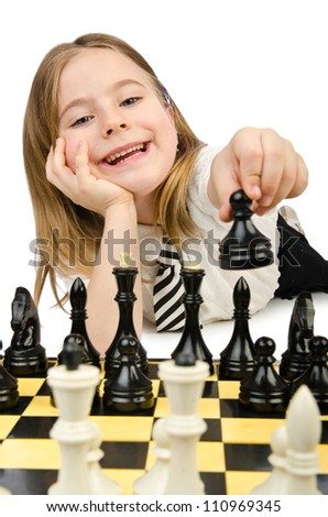 Cute girl playing chess on white - stock photo