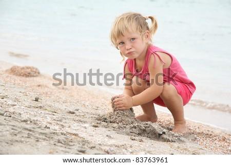 cute girl playing on beach - stock photo