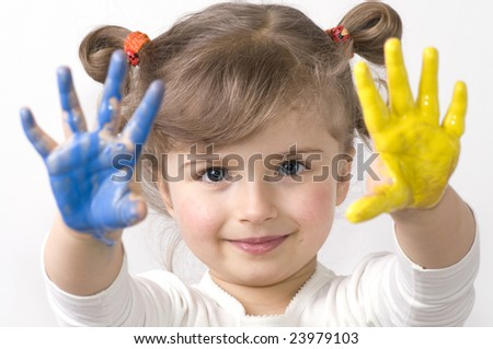 Cute girl playing with colors - stock photo