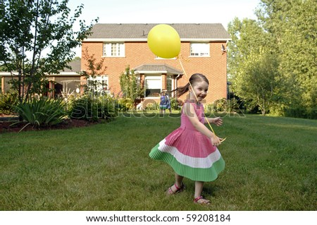Cute girl plays in the garden. - stock photo