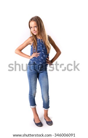 Cute girl posing in blue jeans and vest isolated on white - stock photo