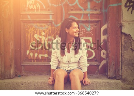 Cute girl posing in the classic European street. - stock photo