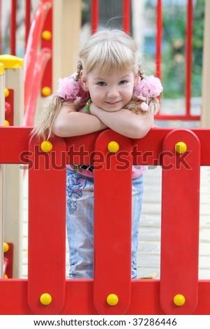 Cute girl posing on the playground. - stock photo
