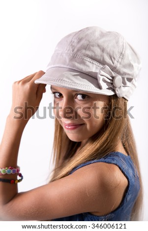 Cute girl posing with a hat on white background - stock photo