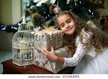 Cute  girl rejoices Gifts for Christmas - stock photo