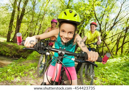 Cute girl riding her mountain bike in the park - stock photo