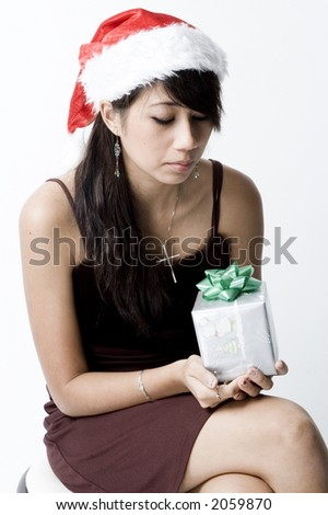 Cute Girl Sitting and Looking At Present