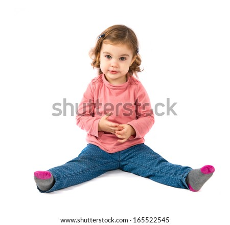 Cute girl sitting over white background