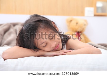 Cute Girl Sleeping With White Blanket In Bed.