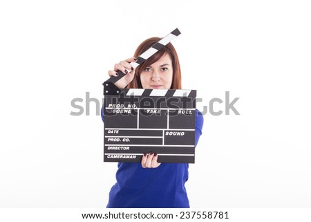 Cute girl smiling holding clapperboard - stock photo