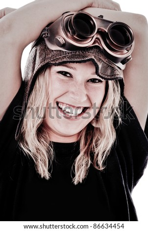 Cute Girl smiling wearing Steam Punk Goggles and Aviation Hat - stock photo