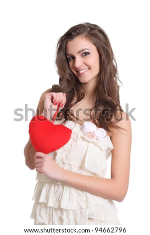 Cute girl smiling with a red heart sign - stock photo