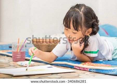 cute girl student enjoy to play paint color