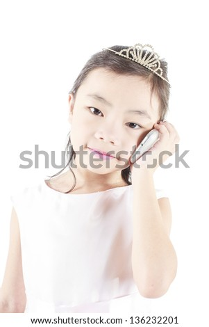 Cute girl use a mobile phone with isolated background. - stock photo