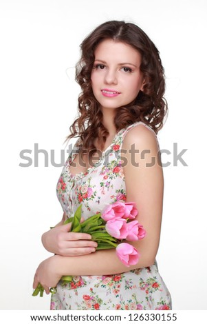 Cute girl wearing clothes with floral ornament on Holiday theme - stock photo