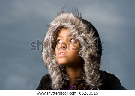 cute girl wearing hoodie looking at the dark sky