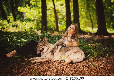 cute girl with a dog resting on the morning forest - stock photo