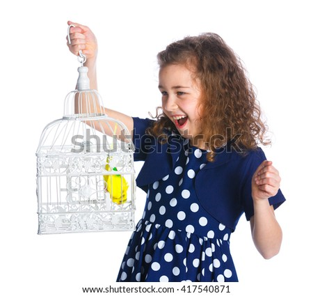 Cute girl with a parrot in a cage. Isolated on the white background - stock photo