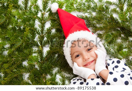cute girl with a red christmas hat - stock photo