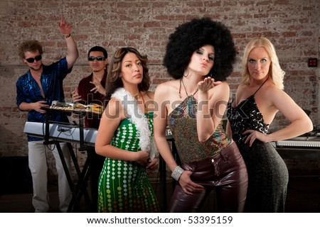 Cute girl with afro blowing a kiss at 1970s Disco Music Party - stock photo