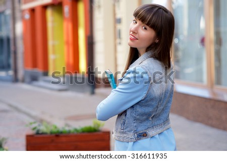 Cute girl with beautiful smile on the street