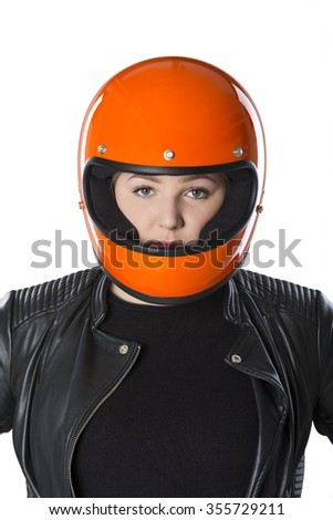 Cute girl with blond hair with orange motorcycle helmet. Studio shot on white background.