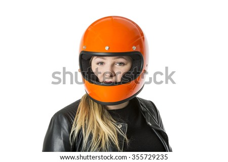 Cute girl with blond hair with orange motorcycle helmet. Studio shot on white background. - stock photo