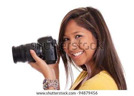 Cute girl with digital camera - stock photo