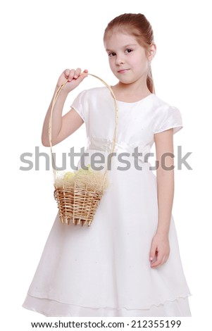 Cute girl with Easter basket on white background