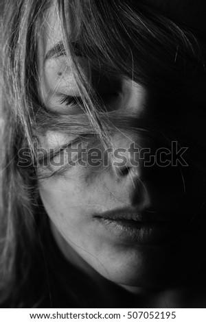 Cute girl with hair on face. Black and White. Close up