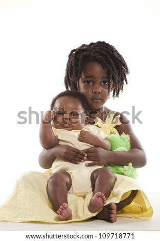 Cute Girl with Her Baby Brother - stock photo