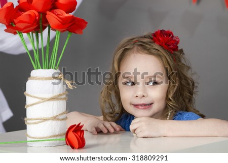 Cute girl with her eyes closed and her chin in hand.Isolated on white background. - stock photo