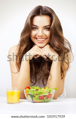 cute girl with juice and salad - stock photo