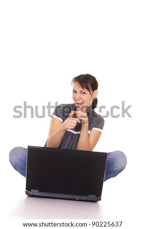 cute girl with laptop sitting on white