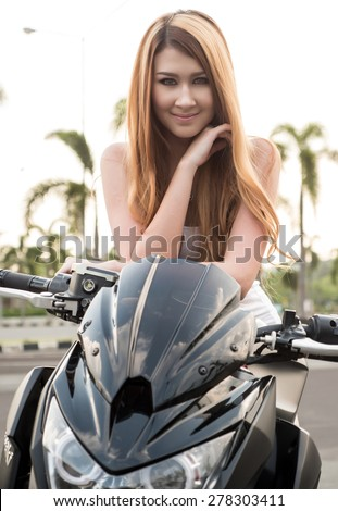 Cute Girl With Naked Sport Bike - stock photo