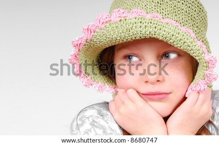 Cute girl with old fashioned hat