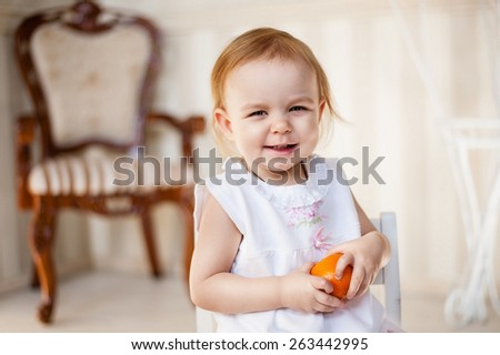 Cute girl with orange - stock photo
